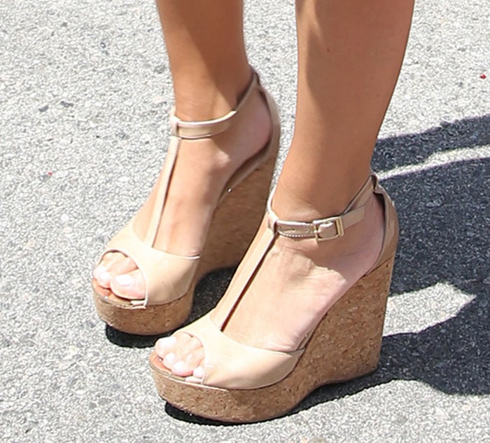 Maria Menounos shows off her feet in nude Jimmy Choo wedge sandals