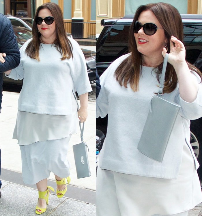 Melissa McCarthy's gray Prada clutch and a pair of large sunglasses