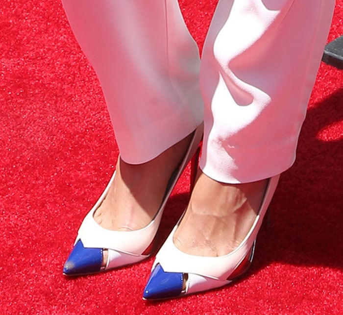 Michelle Rodriguez's sexy feet in Christian Louboutin pumps