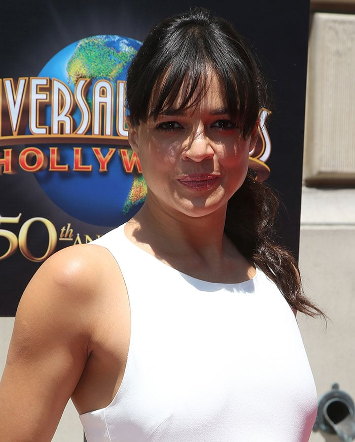Michelle Rodriguez wore her raven wavy hair in a ponytail updo
