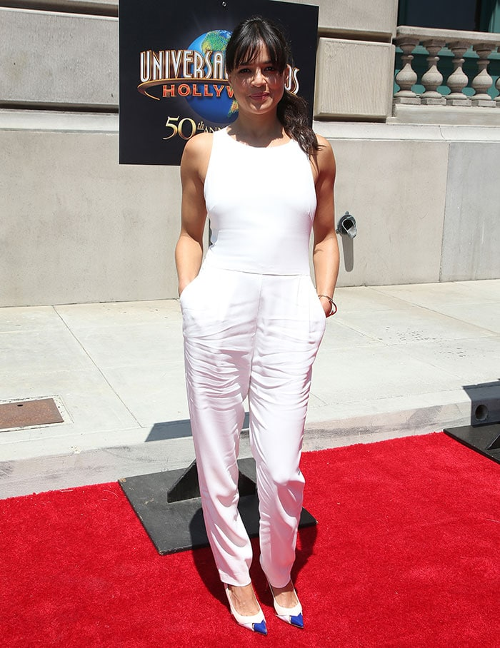 Michelle Rodriguez's white sleeveless jumpsuit highlighted her toned arms and curves