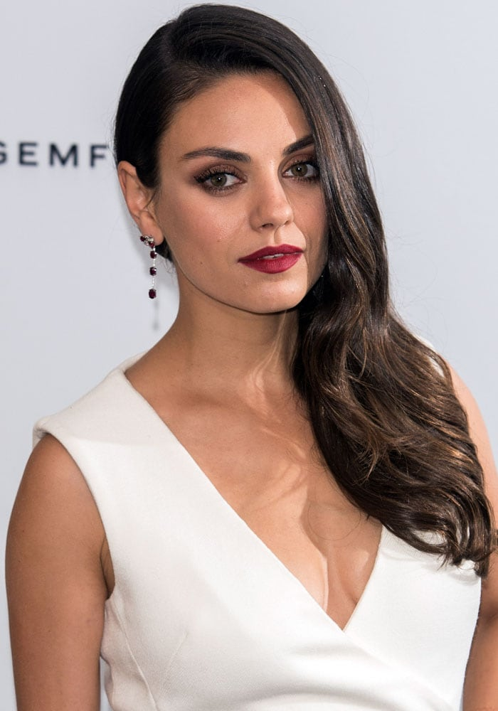 Mila Kunis' sexy red lips and wide eyes
