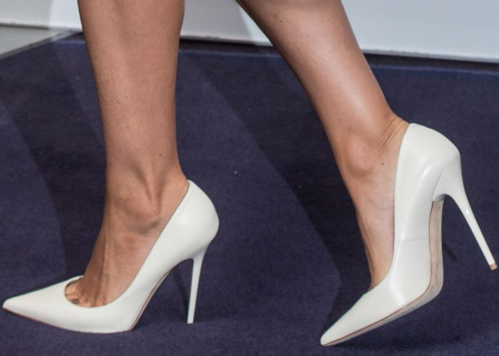 Mila Kunis shows off her hot feet in white Jimmy Choo shoes