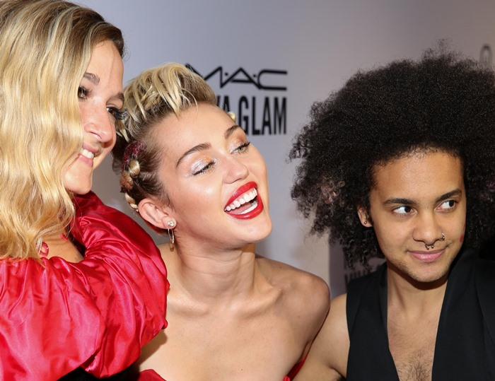 Miley Cyrus poses with friends