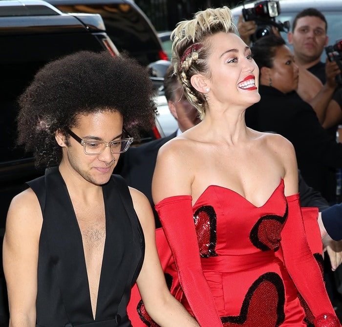 Miley Cyrus and her friend Tyler Ford arrive at the 2015 amfAR Inspiration Gala in New York City