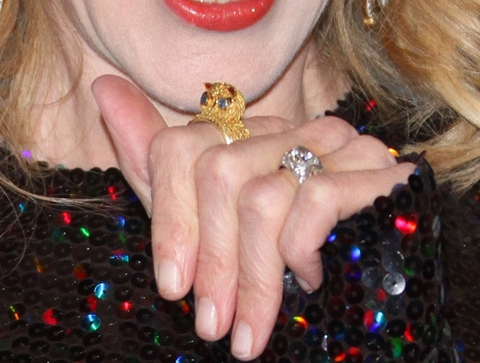 Nicole Kidman showing off her sequined dress and glittering rings