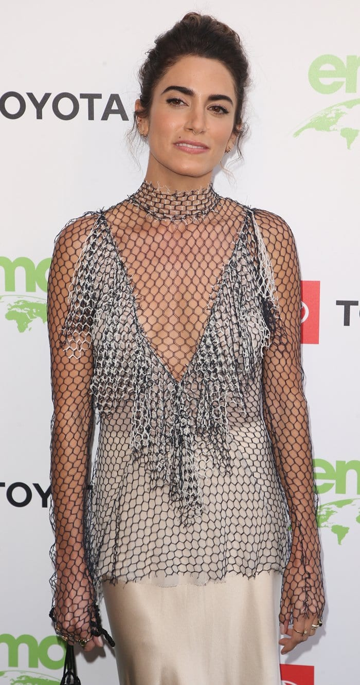 Nikki Reed's fringed fishnet top and creamy silk maxi skirt