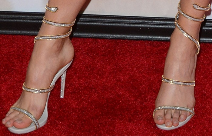 Lexi Atkins' feet in Rene Caovilla crystal snake-coil sandals