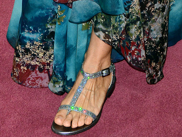 Sarah Jessica Parker's feet in a glittery blue flat sandal design from her own shoe line