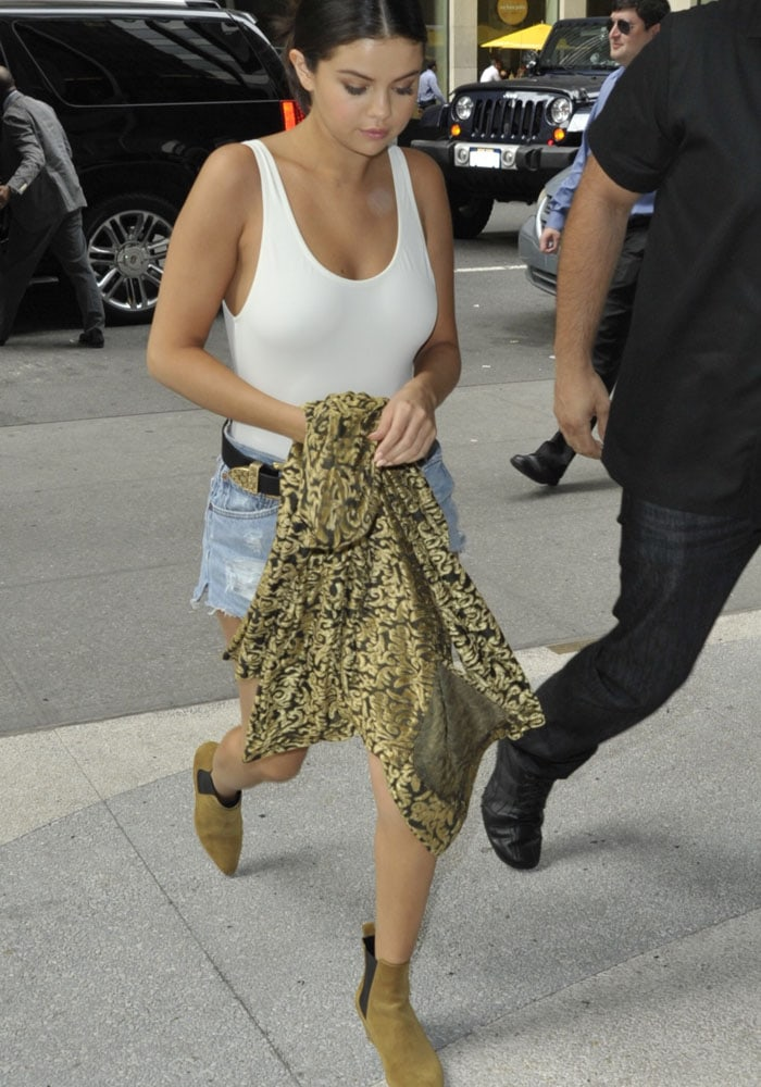 Selena Gomez completed her look with Saint Laurent Chelsea ankle boots