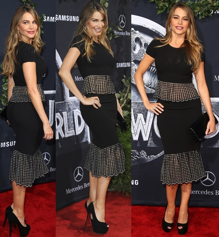 Sofia Vergara flashed her legs in a mermaid-style skirt and a short-sleeved black-and-white crop peplum blouse
