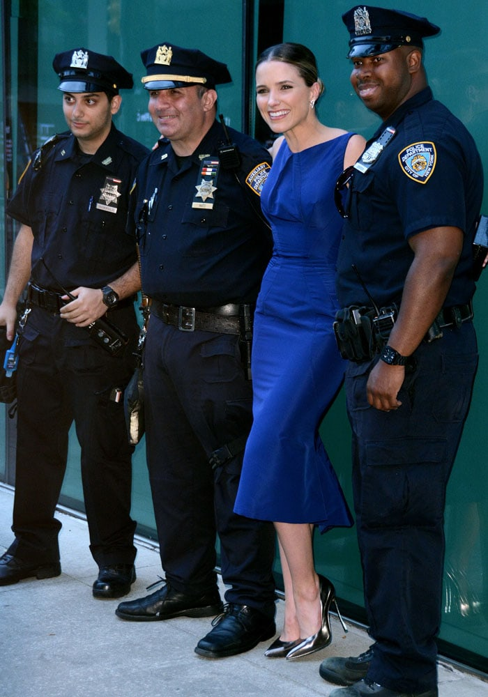 Sophia Bush posing with New York Police Department officers