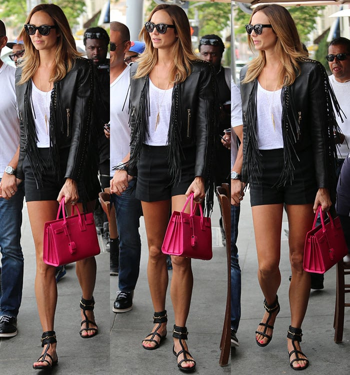 Stacy Keibler displaying her endless legs in shorts and a Balmain fringe jacket