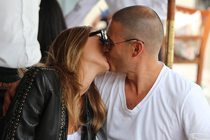 Stacy Keibler kissing her husband Jared Pobre