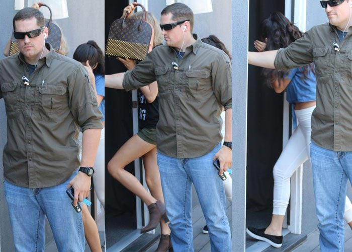 Taylor Swift and Selena Gomez trying to hide from the photographers