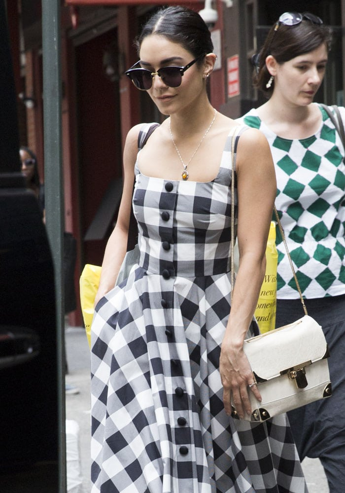 Actress and singer Vanessa Hudgens strolls through New York City on her way to an ATM