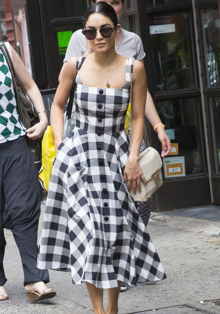 Vanessa Hudgens hid her eyes behind a large pair of dark sunglasses and tucked her hair back and out of her face