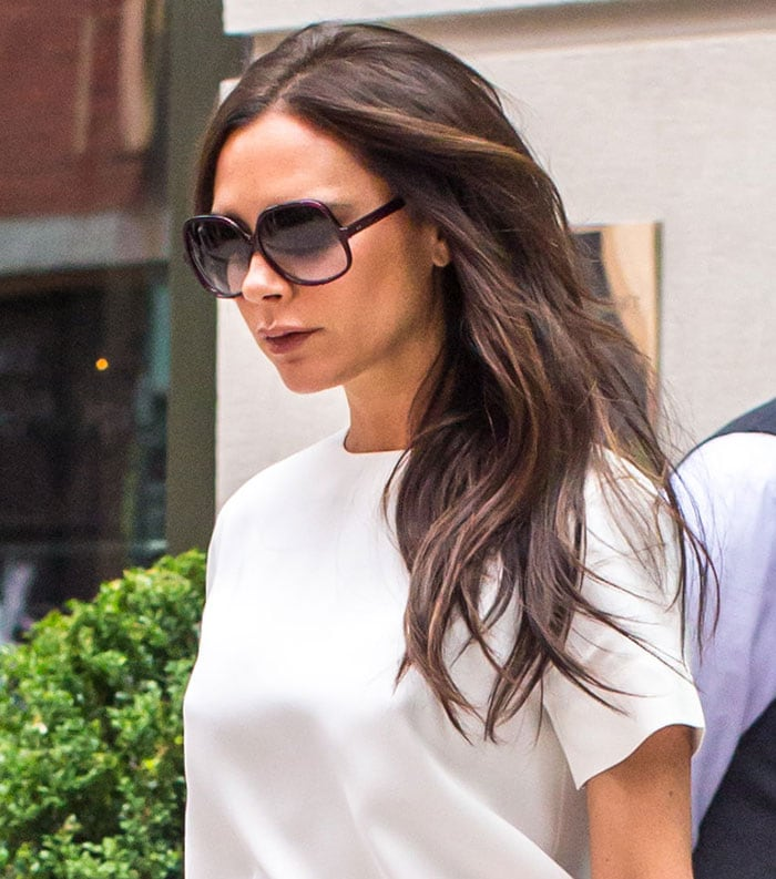 Victoria Beckham's white silk short-sleeved top and oversized sunglasses