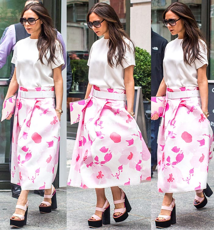 Victoria Beckham in a floral skirt while leaving her hotel
