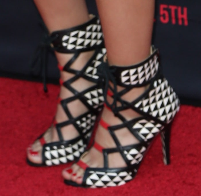 Becky G's feet in lace-up sandals from Latina designer Alejandra G
