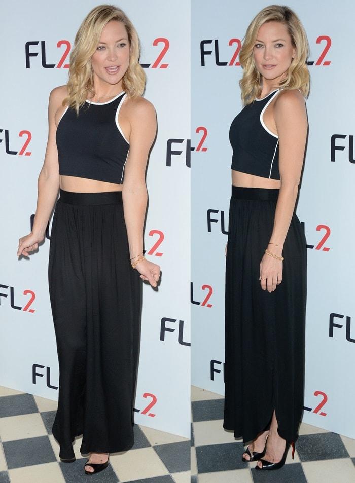 Kate Hudson rocks a Fabletics crop top and black silk pants