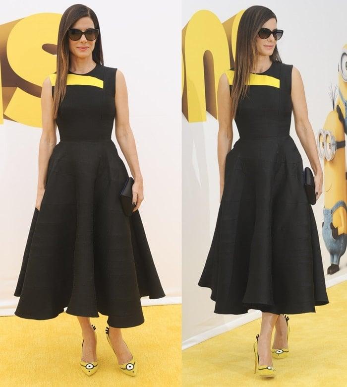 Sandra Bullock ina figure-flattering Roksanda dress and cat-eye sunglasses