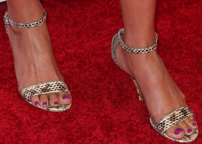 Ali Larter shows off her pedicure in a pair of snakeskin-print ankle strap sandals