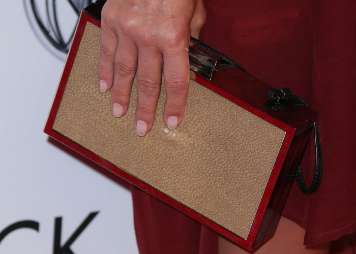 Ali Larter shows off her fresh manicure while clasping a clutch