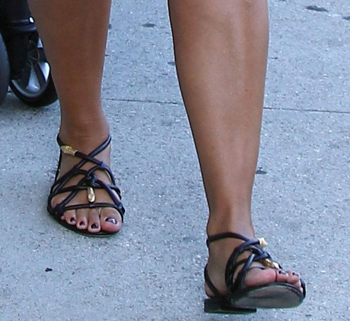 Amber Rose wearing black strappy cage sandals