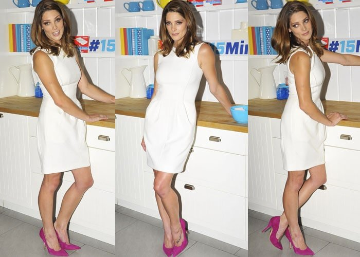 Ashley Greene in a white dress and fuchsia suede Paul Andrew pumps
