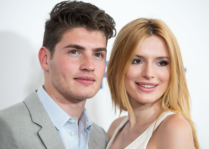 Actress Bella Thorne and her beau Gregg Sulkin pose together for a photo on the red carpet at the 6th Annual Thirst Gala held at The Beverly Hilton hotel in Los Angeles on June 30, 2015