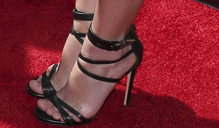 Britney Spears wearing ankle-strap sandals from the luxury Italian shoe brand Le Silla