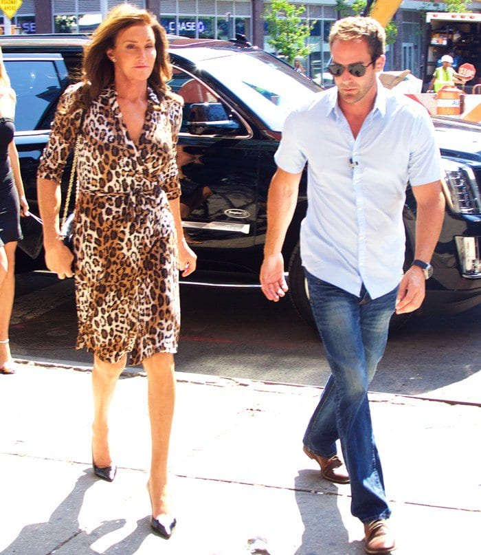 Caitlyn Jenner sports a leopard print dress and high heels as she arrives at an office building in Manhattan on June 30, 2015
