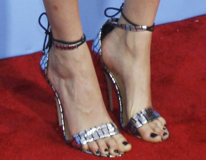 Cara Delevingne shows off her feet in silver ankle strap heels by Alejandra G