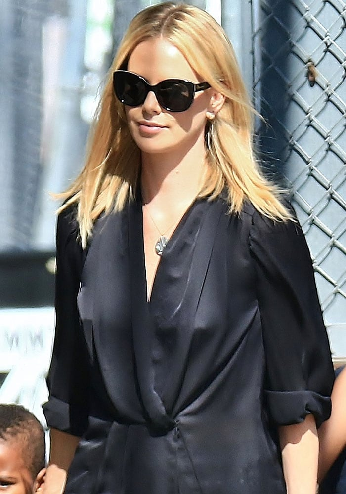 Charlize Theron's oversized tie-front black blouse