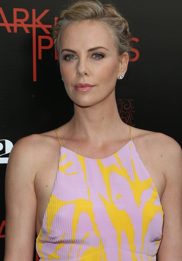 Charlize Theron accessorized with Harry Winston jewelry