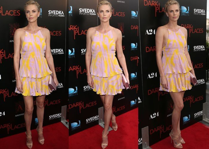 Charlize Theron flaunted her legs in a summery halter dress