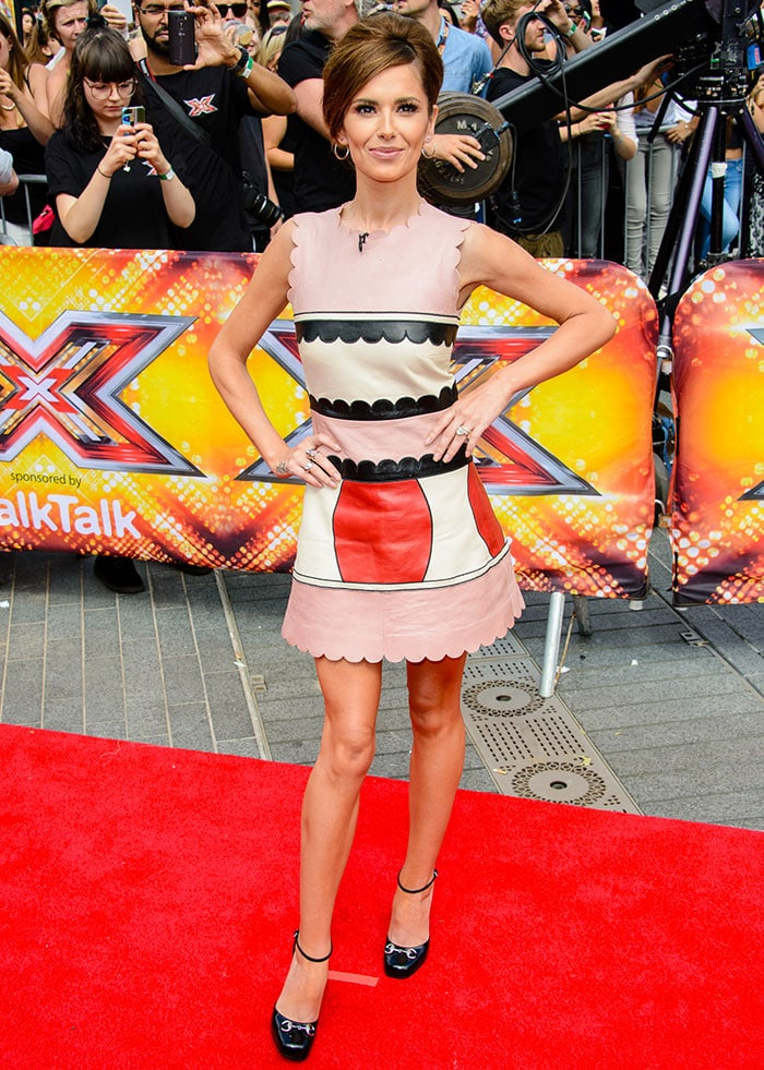 Cheryl Cole showed off her hot legs in a '60s-inspired fit-and-flare leather mini dress