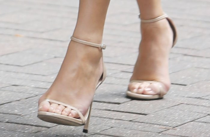 Chrissy Teigen shows off her feet inStuart Weitzman Nudist sandals