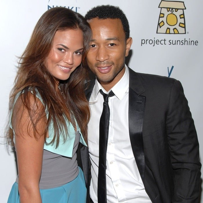 John Legend and Chrissy Teigen attend the Project Sunshine charity event at Nikki Beach in New York City on September 22, 2009