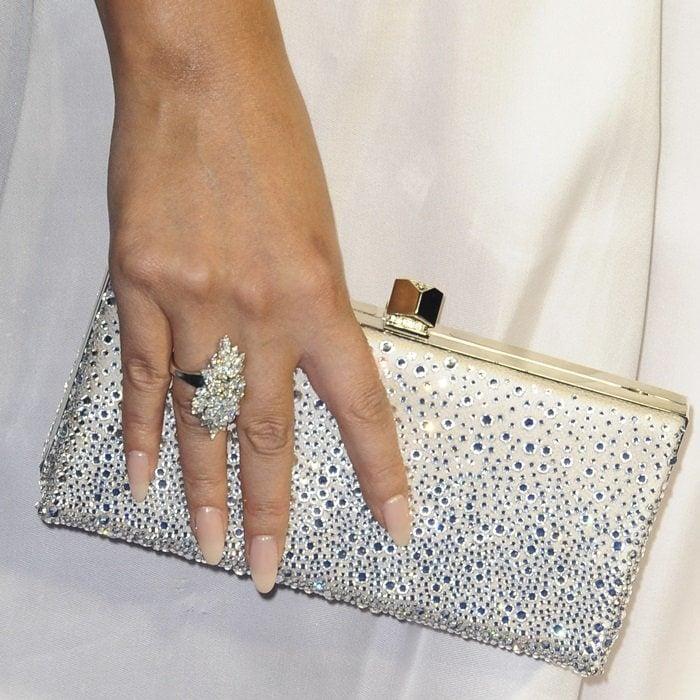 Chrissy Teigen'ssparkling glittery champagne tone leather Celeste clutch