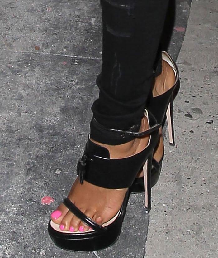 Christina Milian showed off her hot feet in black platform shoes
