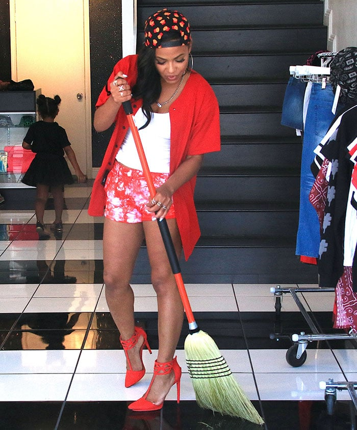 Christina Milian sweeps the floor at her We Are Pop Culture pop-up shop on Melrose Avenue in Los Angeles on July 14, 2015