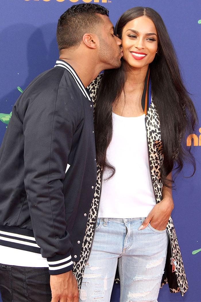 Ciara getting a kiss on the cheek from boyfriend Russell Wilson