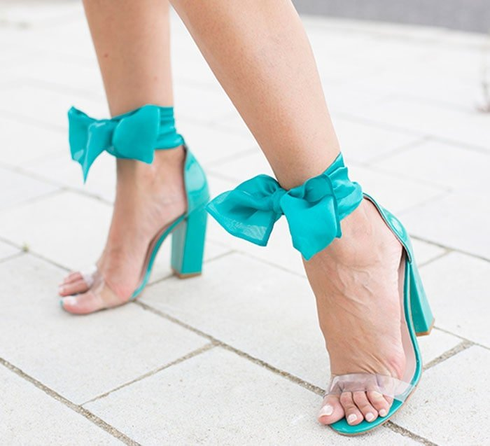 Cristina's hot feet in turquoise sandals