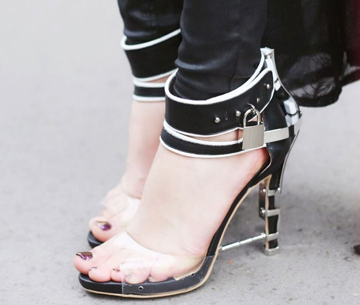 Damy's hot feet in fashion-forward heels with silver-tone metal plates and screws