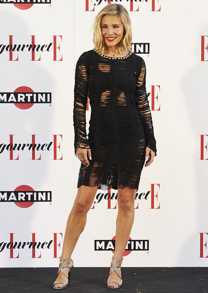 Elsa Pataky flashes some skin on the black carpet in a long-sleeved torn dress