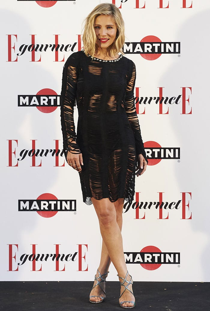 Elsa Pataky shows some skin in a tattered-looking black dress