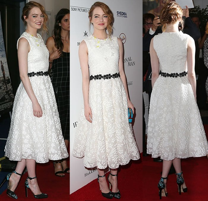 Emma Stone's dress was styled with a black floral band around her waist
