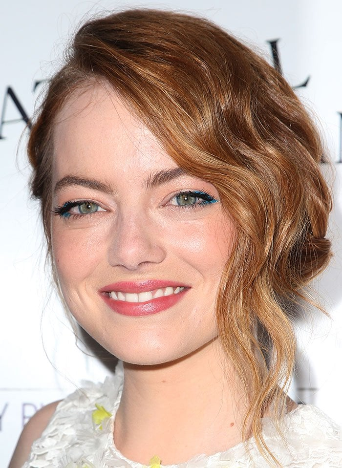 Emma Stone's wavy blonde tresses in a chic side-swept updo